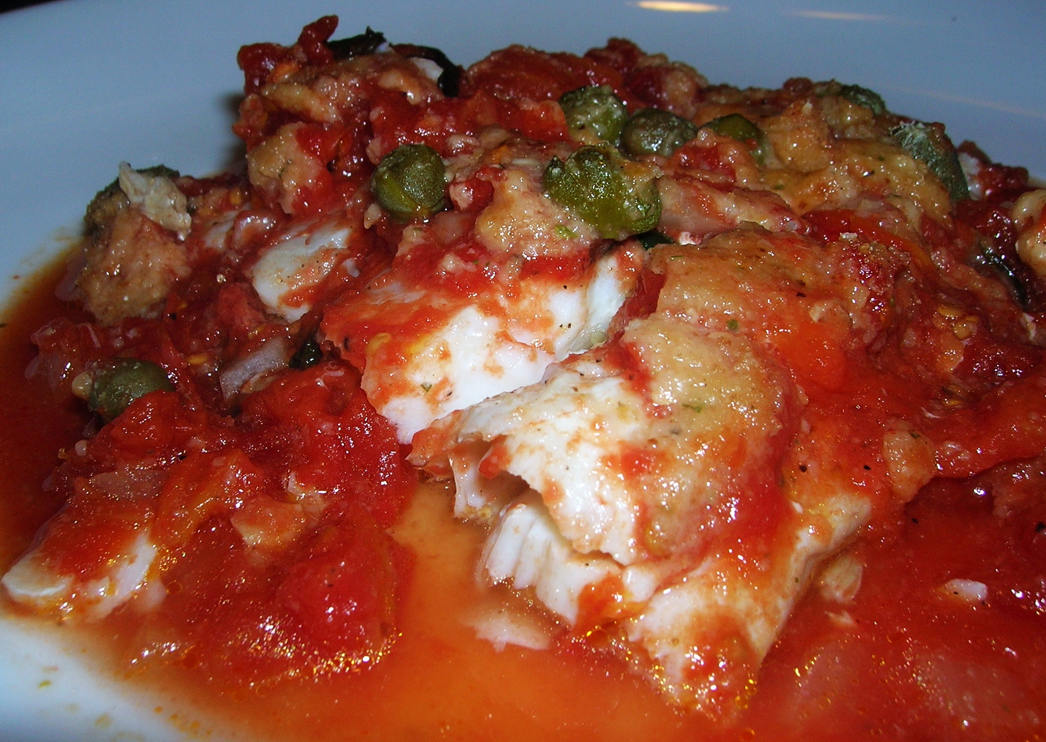 Baked scrod with chunky tomatoes and capers for Fish in tomato sauce